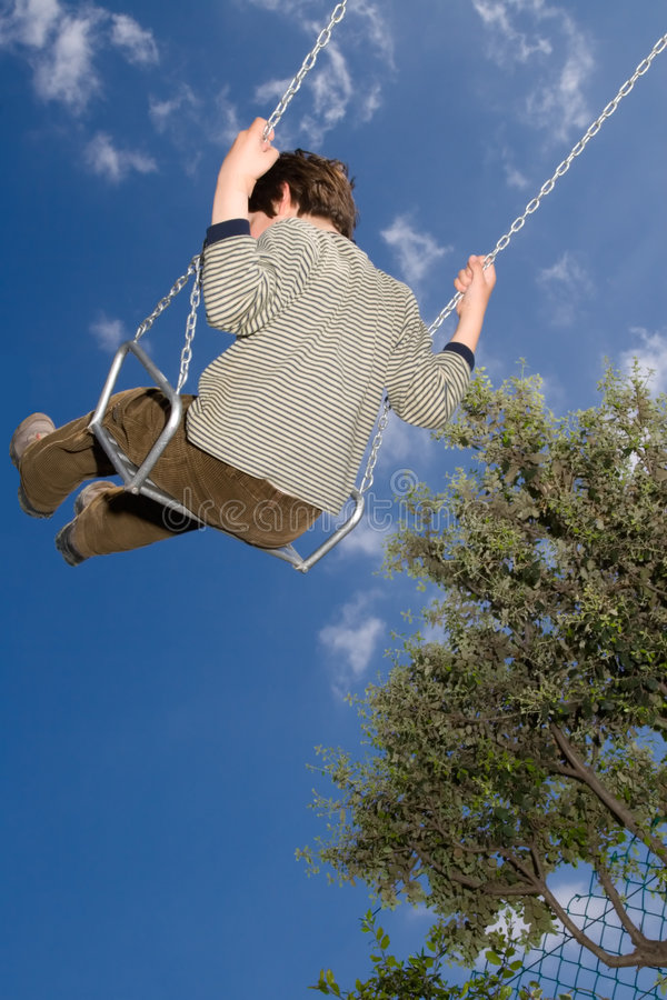 Kid in a swing stock photos