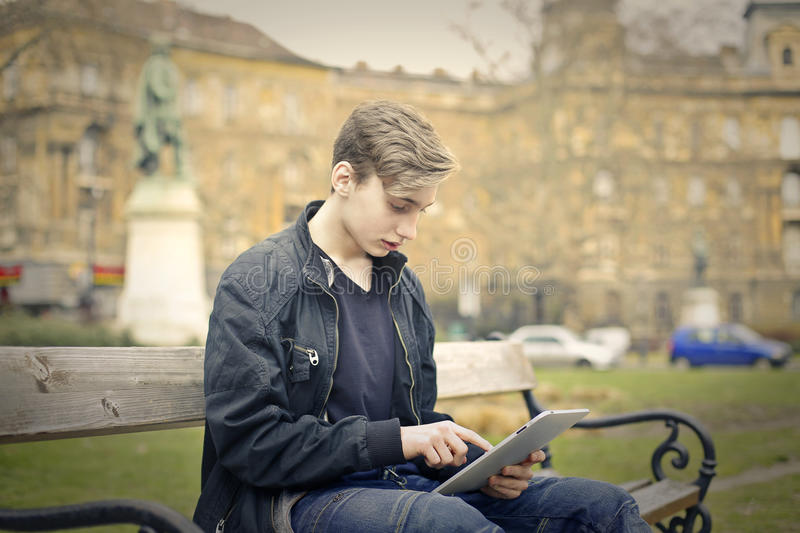 Kid with tablet royalty free stock images