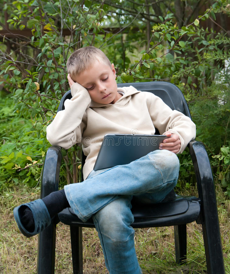 Download Kid with tablet pc. stock image. Image of pensive, laptop - 33441373