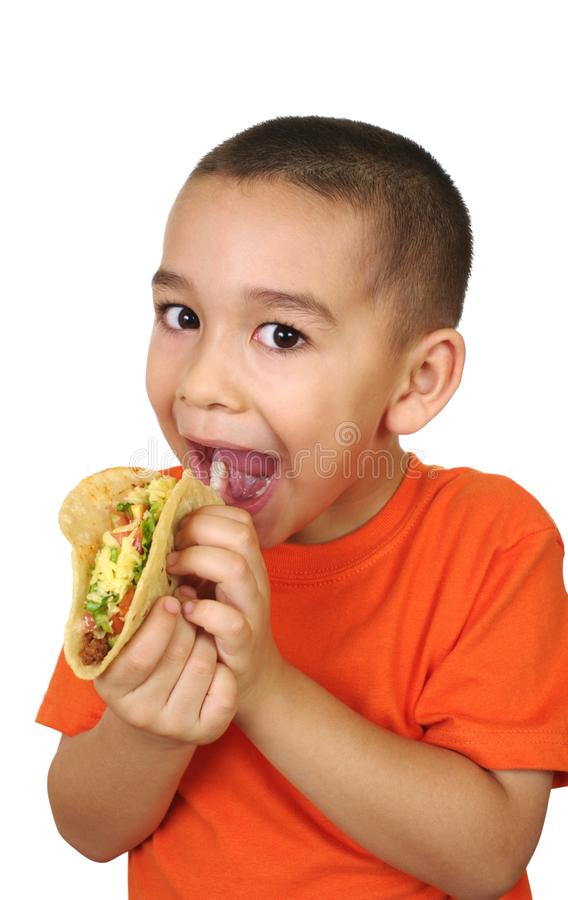 Kid with a taco stock photography