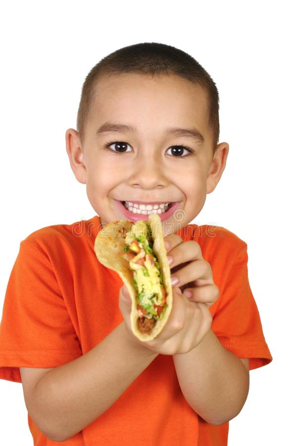 Kid with a taco stock image