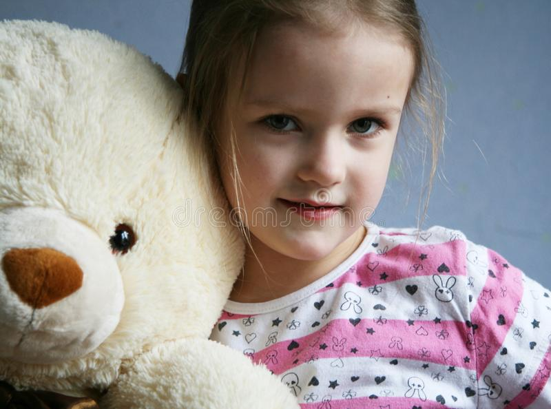 Kid with teddy royalty free stock photography