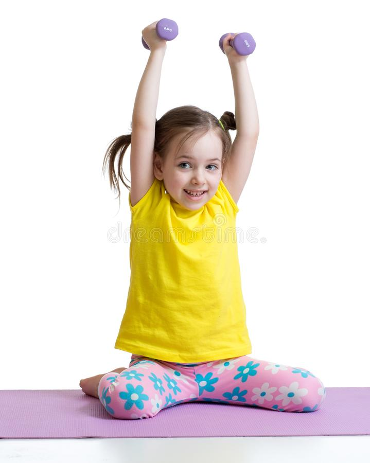 Kid toddler doing exercises with dumbbells, white background, concept of healthy lifestyle royalty free stock images