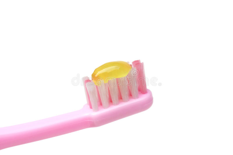 Kid toothbrush. Toothbrush for kid with toothpaste closeup stock image