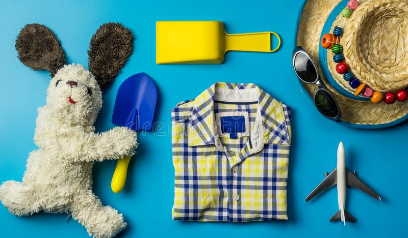 Kid travel objects concept on blue stock photography