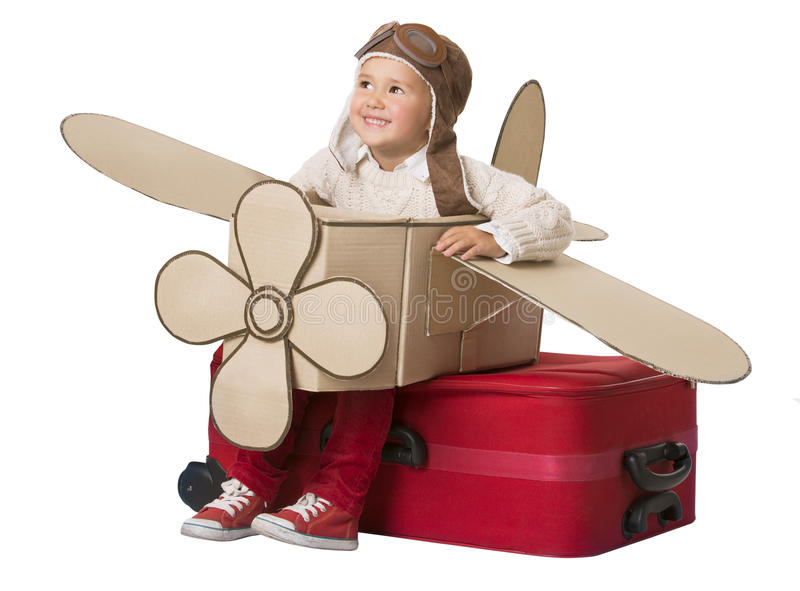 Kid Travel on Toy Airplane, Child Sitting on Vacation Suitcase stock photo
