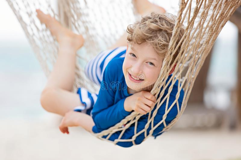 Kid at tropical vacation stock photography