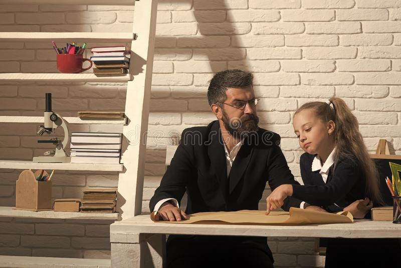 Kid and tutor with strict and smart faces stock image