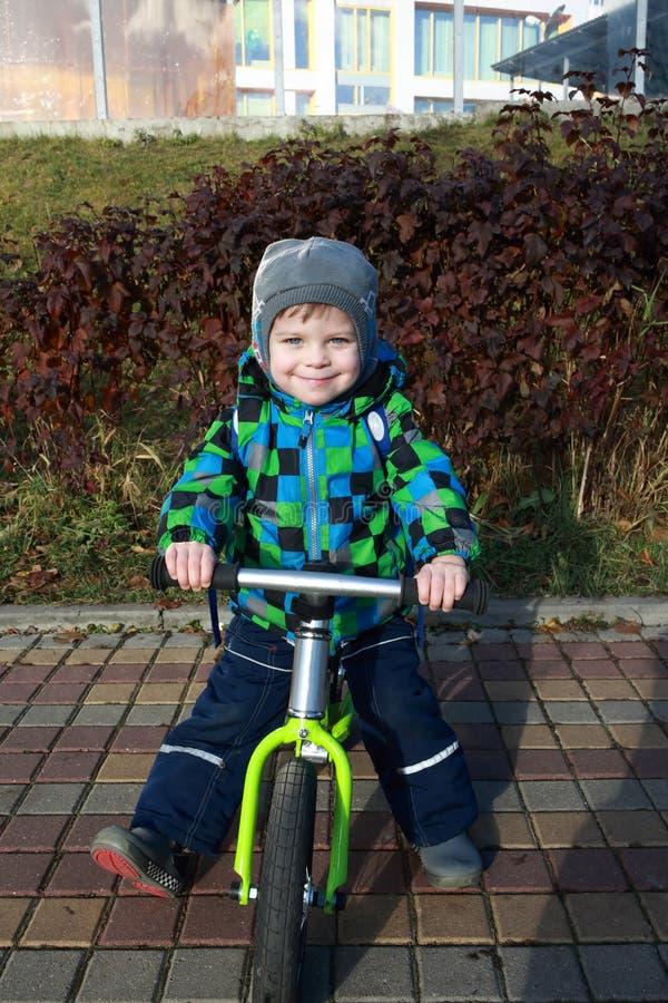 Kid using balance bike stock image