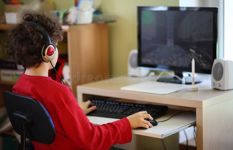 Kid using computer royalty free stock photography
