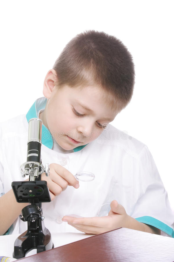 Download Kid using magnifying glass stock image. Image of child - 13478515