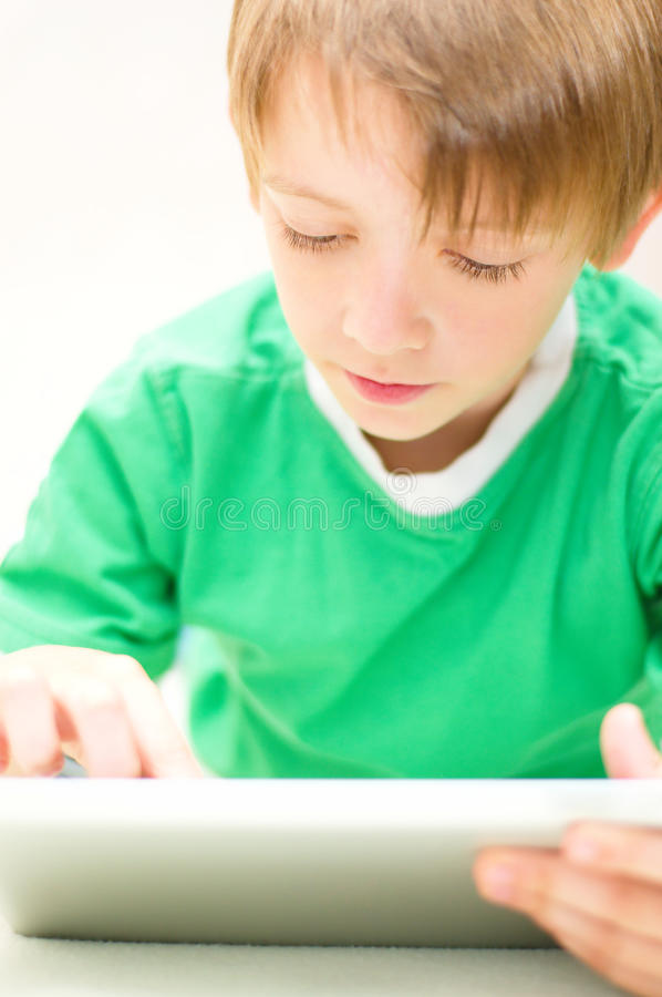 Download Kid using tablet computer stock image. Image of caucasian - 33649017