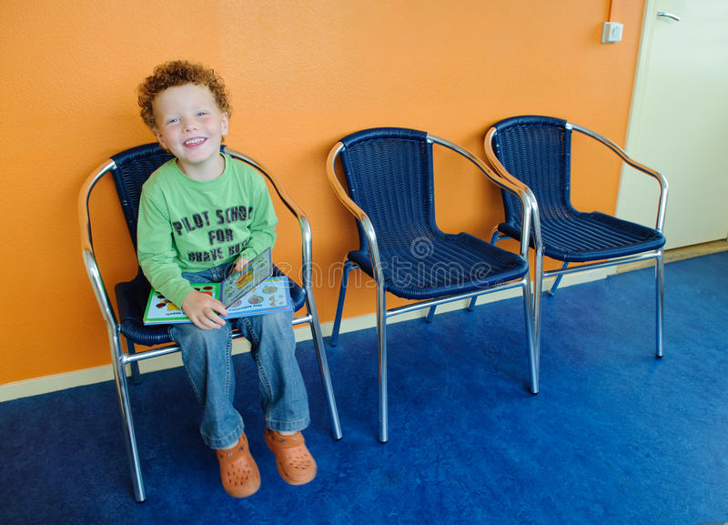 Kid in waiting room stock images