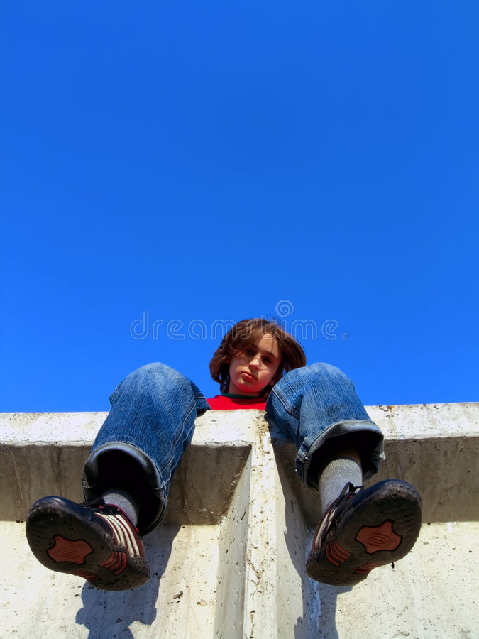 Kid on a wall royalty free stock image