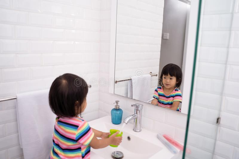Kid wash her mouth or gargle stock images