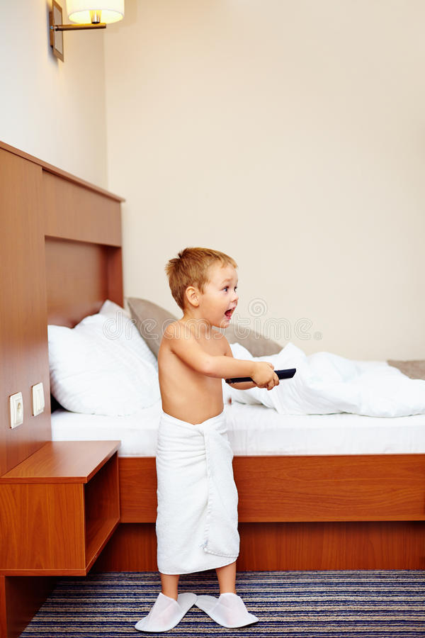 Download Kid Watching Tv In Hotel Room After Bathing Stock Image - Image of happy, apartment: 34118403