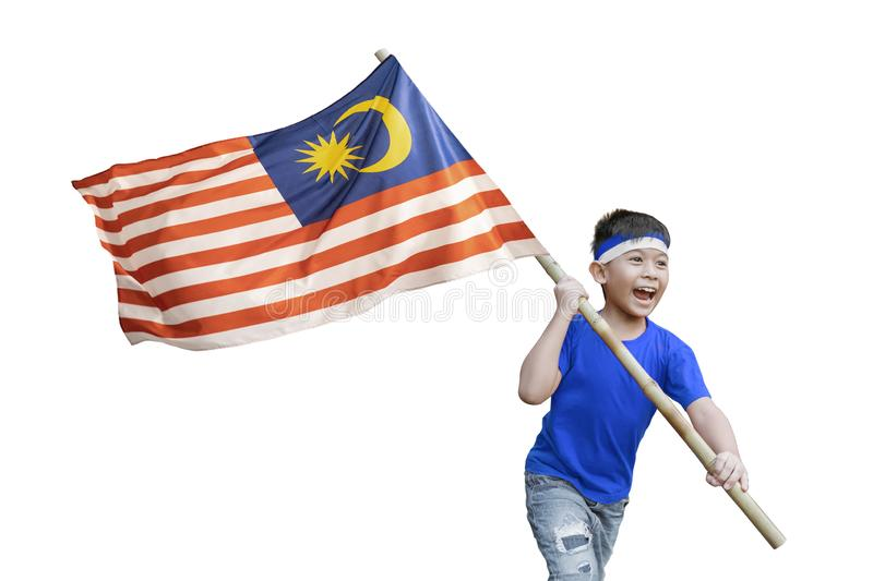 Kid waving malaysian flag on independence day celebration isolated. Proud kid waving malaysian flag on independence day celebration isolated over white stock image