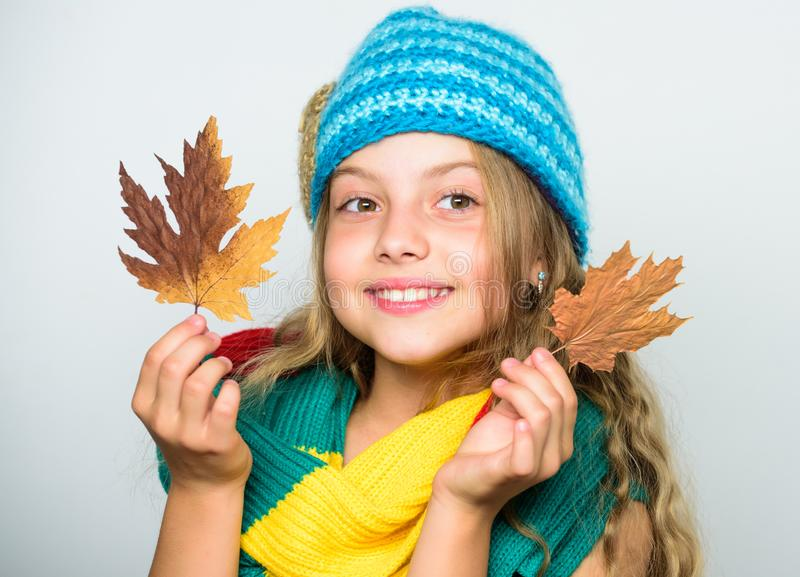 Kid wear warm knitted hat and long scarf. Fall fashion concept. Which fabrics will keep you warmest this autumn. Warm royalty free stock photo