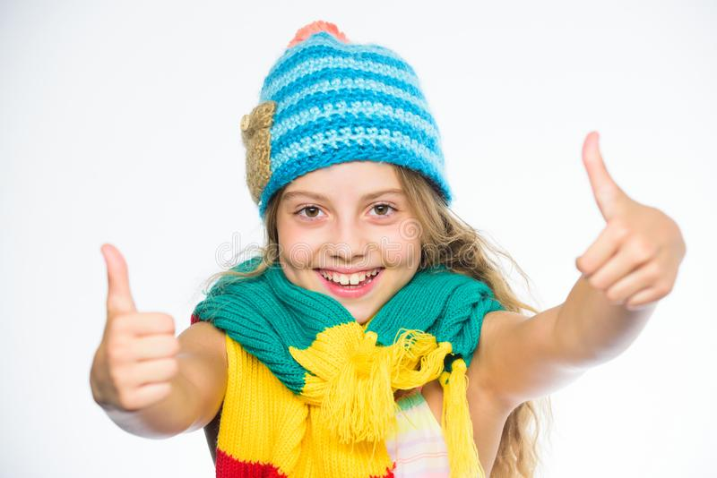 Kid wear warm soft knitted blue hat and long scarf. Warm woolen accessories. Girl long hair happy face white background royalty free stock photography
