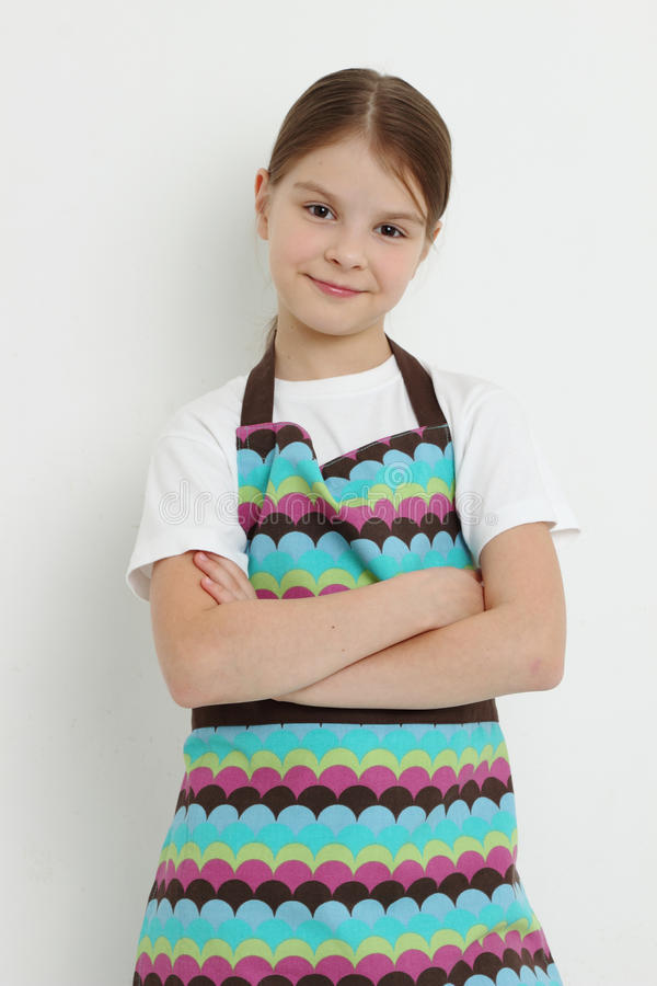 Kid wearing colorful apron royalty free stock photo