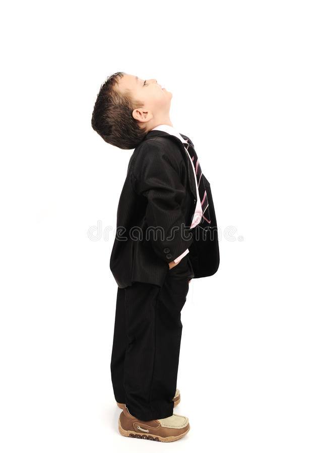 Kid wearing suit looking up. Kid wearing suit isolated looking up stock photography
