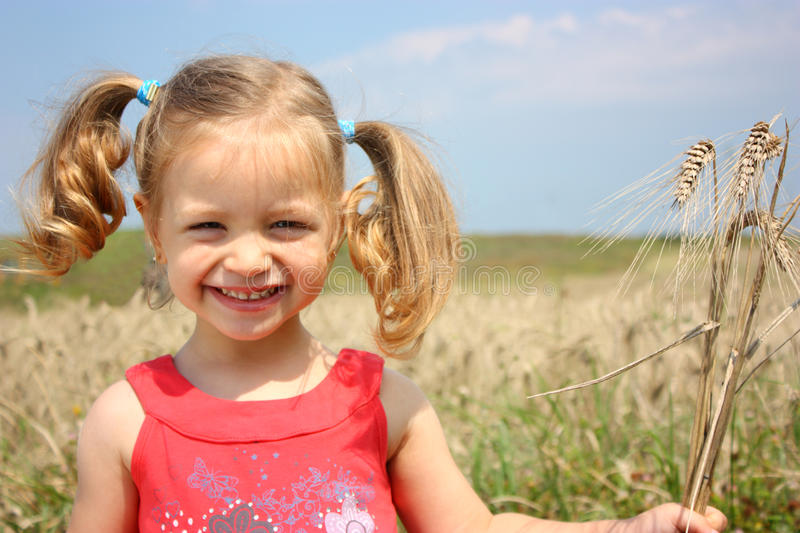 A kid with wheat royalty free stock photos