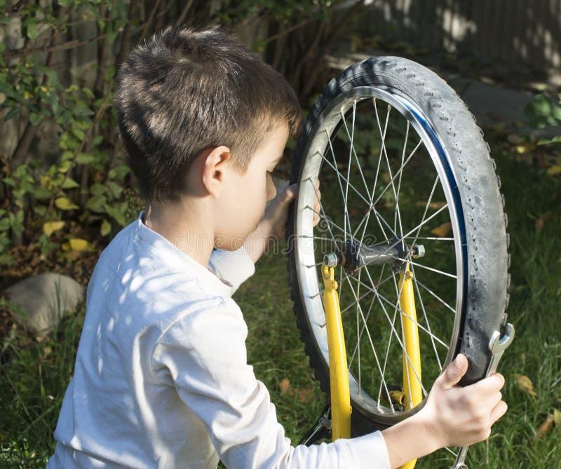 Kid who fix bikes royalty free stock photography