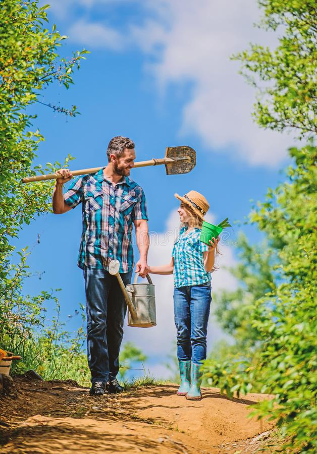 Kid worker with dad hold box. family bonding. spring country side village. father and daughter on rancho. summer farming royalty free stock photo