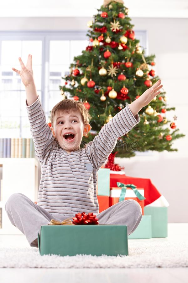 Download Kid Yelling Happily At Christmas Gift Stock Photo - Image: 21535202
