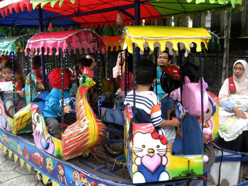 Kiddie ride. The kids were enjoying the kiddie ride at a theme park in the city of Solo, Central Java, Indonesia royalty free stock images