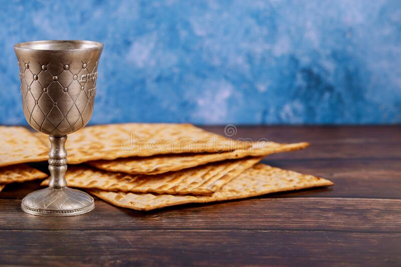 Kiddush cup of wine with matzos bread. Jewish pesah holiday royalty free stock photo