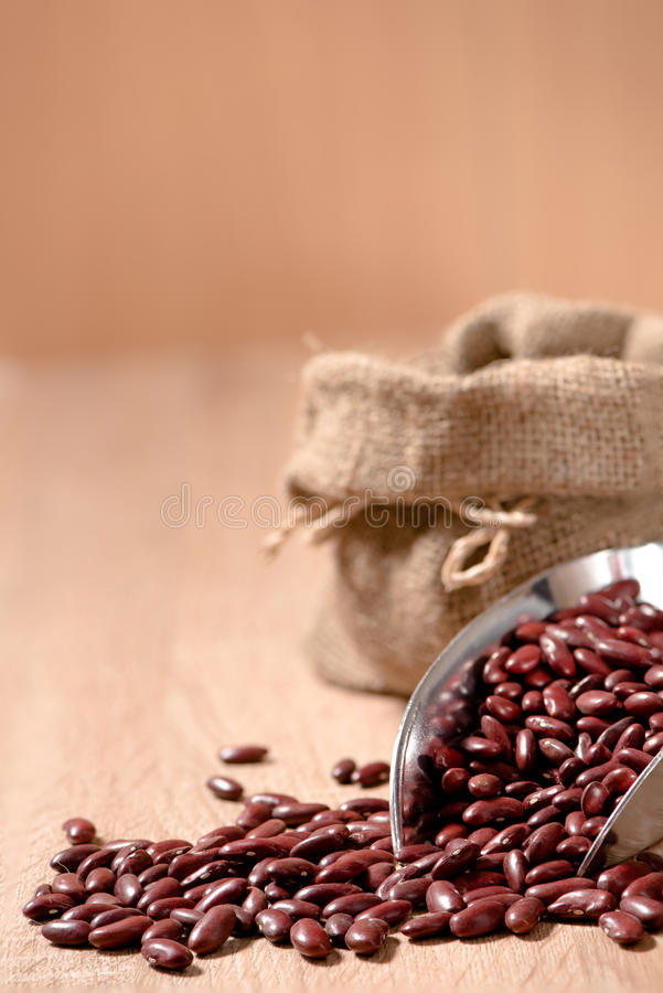 Download Kidney Bean,Red Beans In Metal Scoop On Wood Table Stock Photo - Image of wooden, pinto: 65609820