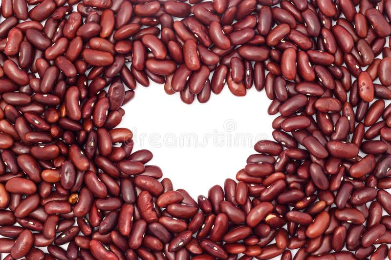 kidney beans background with heart shape center royalty free stock photography
