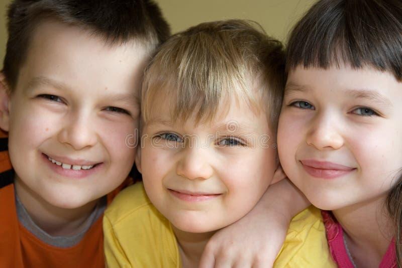 Kids. Closeup shot of three young kids