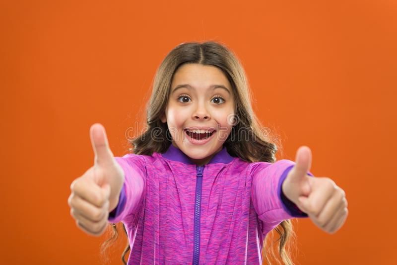 Kids actually like concept. Kid show thumb up. Girl happy totally in love fond of or highly recommend. Thumb up. Approvement. Girl cute child show thumbs up stock photo