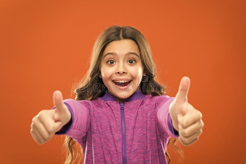 Kids actually like concept. Kid show thumb up. Girl happy totally in love fond of or highly recommend. Thumb up. Approvement. Girl cute child show thumbs up stock photography