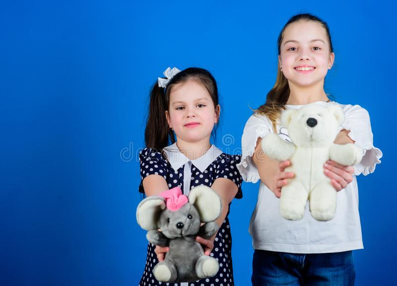 Kids adorable cute girls play with soft toys. Happy childhood. Child care. Excellence in early childhood education. Sisters or best friends play with toys royalty free stock image