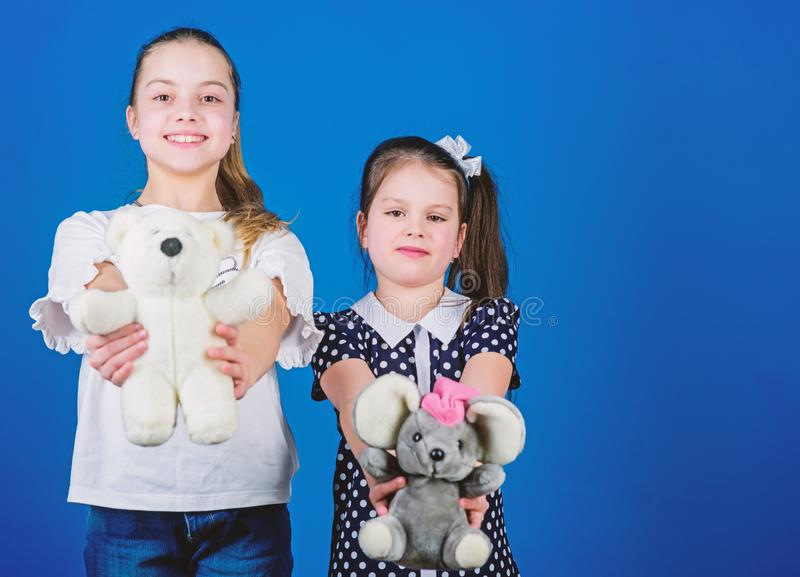 Kids adorable cute girls play with soft toys. Happy childhood. Child care. Excellence in early childhood education. Sisters or best friends play with toys royalty free stock photos