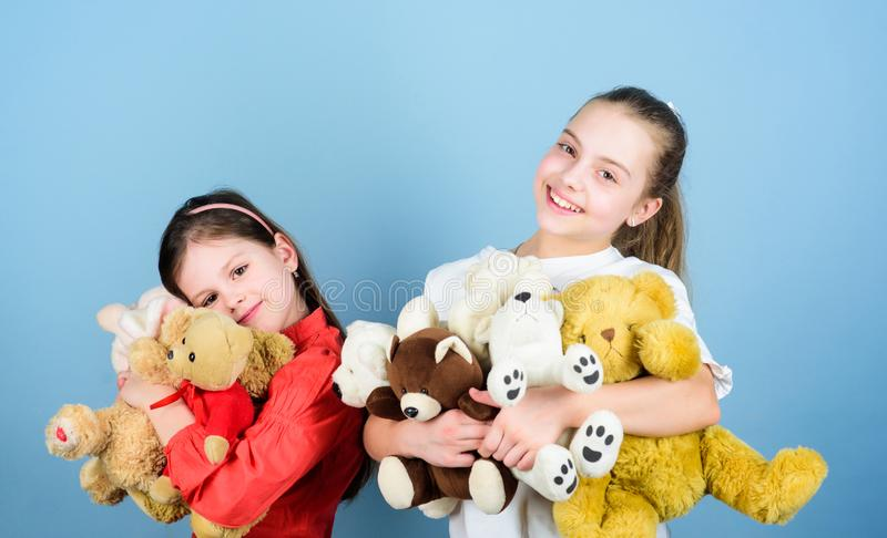 Kids adorable cute girls play soft toys. Happy childhood. Child care. Sisters best friends play. Sweet childhood. Childhood concept. Softness and tenderness stock photos