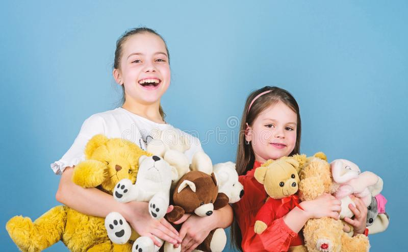 Kids adorable cute girls play soft toys. Happy childhood. Child care. Sisters best friends play. Sweet childhood royalty free stock photo