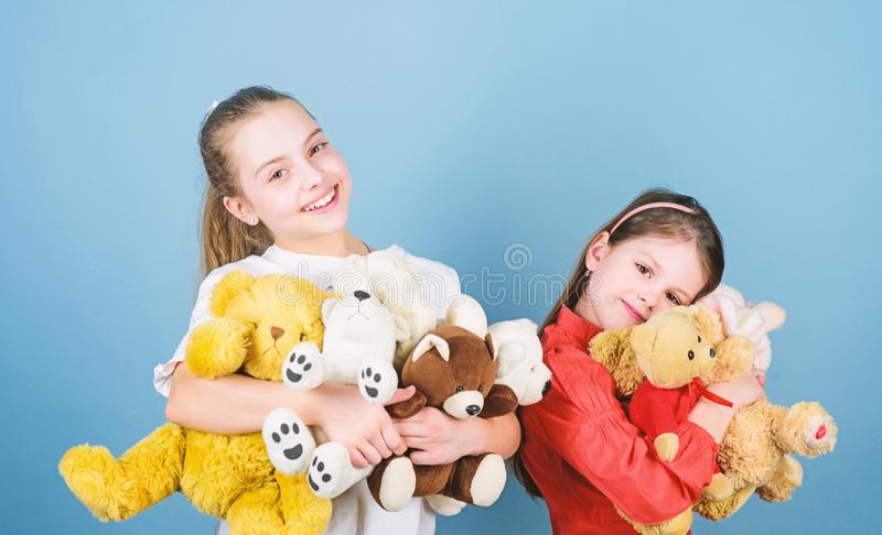 Kids adorable cute girls play soft toys. Happy childhood. Child care. Sisters best friends play. Sweet childhood stock image