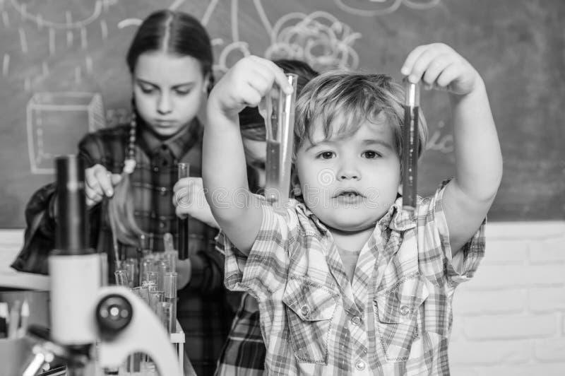 Kids adorable friends having fun in school. School chemistry lab concept. Practicum based teacher professional stock images