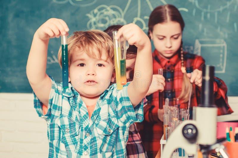 Kids adorable friends having fun in school. School chemistry lab concept. Practicum based teacher professional. Development program. Practical knowledge. Child royalty free stock image