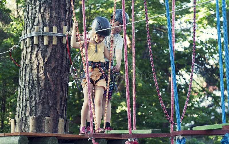 Kids in adventure park royalty free stock images