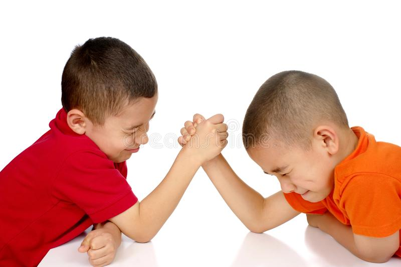 Kids arm wrestling stock photography