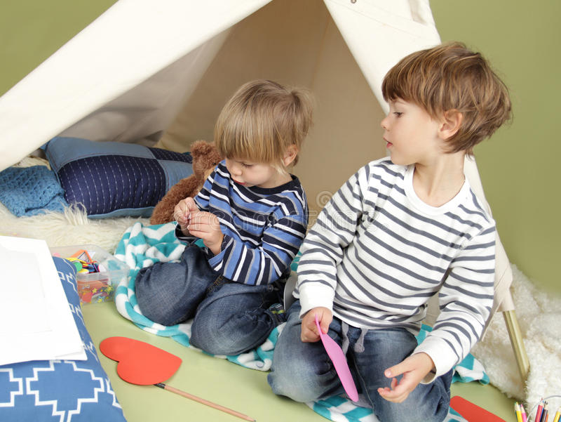 Kids Arts and Crafts Activity, Playing in Teepee Tent stock photography