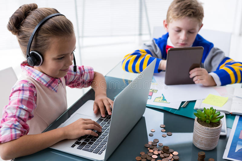 Kids as business executives working together in office. Portrait of kids as business executives working together in office stock images