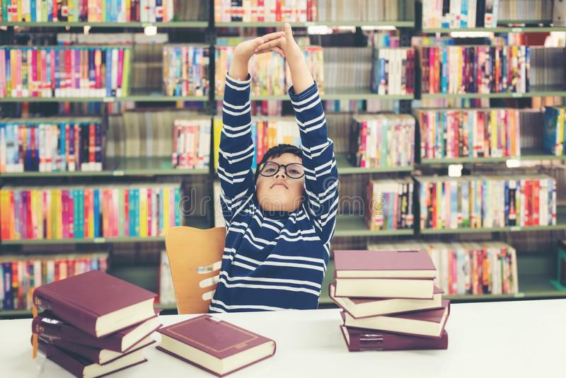 Kids asia boy reading books for education and go to school in library. Education and Lifestyle Concept royalty free stock images