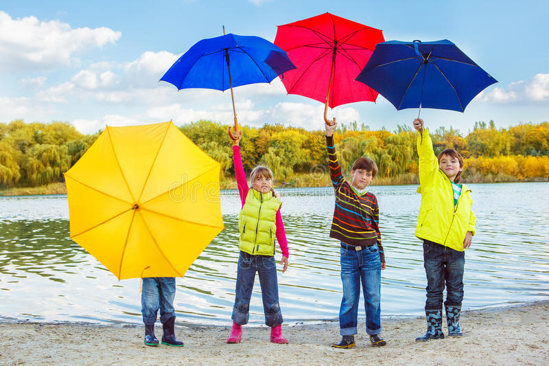 Kids in autumn clothing stock images