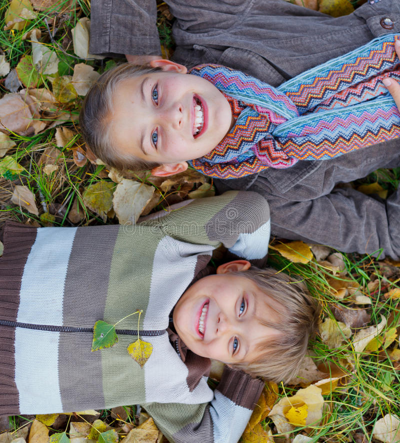 Kids In Autumn Park Stock Photos